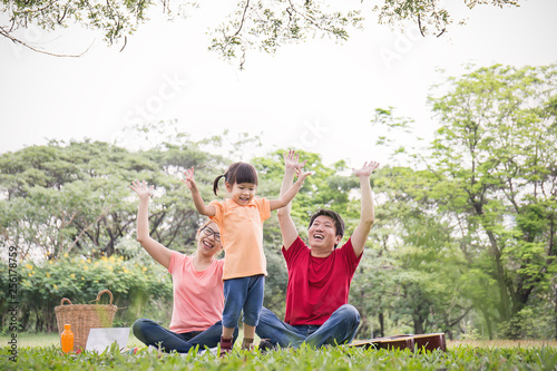 Portrait Of Happy Family Man Woman Little Girl Playing Outside