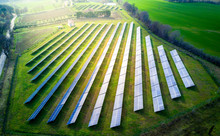 Aerial View Of Solar Panels On A Sunny Day. Power Farm Producing Clean Energy