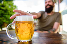 Drinking Alcohol Including Beer. Alcohol Free Beer. Chilled Beer Mug On Cafe Table. Refreshing Alcoholic Drink Or Refresher. Alcohol Addict Sitting In Bar. Having Alcohol Addiction And Bad Habits