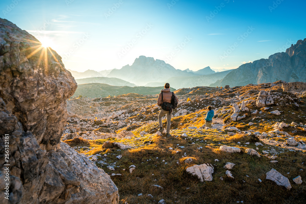 Fototapety, obrazy: two young man enjoying the view of the mountains landscape in the dolomites national park, south tyrol