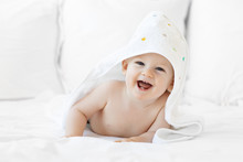 Laughing Baby Boy Wrapped In Towel After Bath