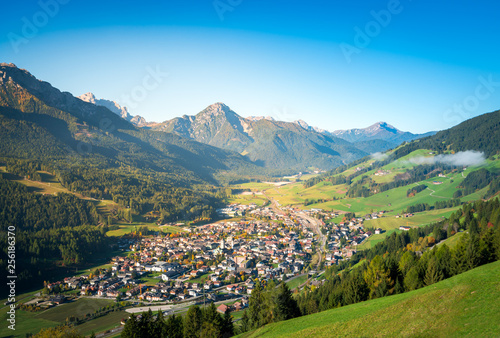 san candido, town in the middle of dolomites mountains Wallpaper Mural