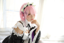Portrait Of Japan Anime Cosplay Woman , White Japanese Maid In White Tone Room