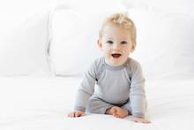 Cute Blonde Baby Boy Sitting O...