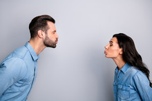 Blind Dating. Profile Side Photo Close Up Of Cute Funny Shy Spouses Sending Air Kisses Closing Eyes Showing Feelings Dressed In Fashionable Blue Jackets Isolated On Ashy-gray Background