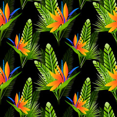Seamless pattern with strelitzia flowers and green tropical leaves on dark background
