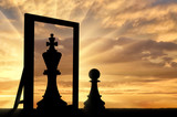 Fototapeta Tęcza - Silhouette of a pawn, sees himself in the reflection of the mirror queen.