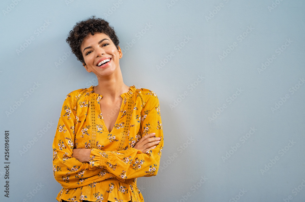 Fototapety, obrazy: Cheerful african woman smiling