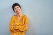Leinwandbild Motiv Cheerful african woman smiling