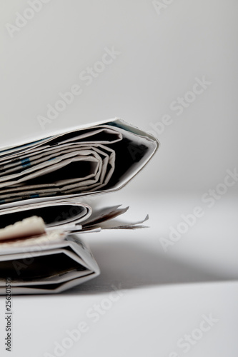 Photo selective focus of newspapers with copy space on grey