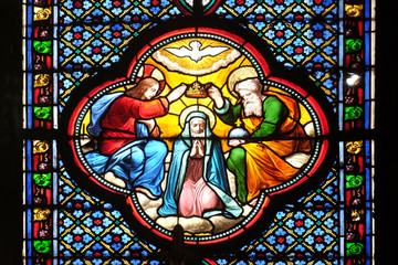 Crowning of the Virgin Mary, stained glass window in the Basilica of Saint Clotilde in Paris, France