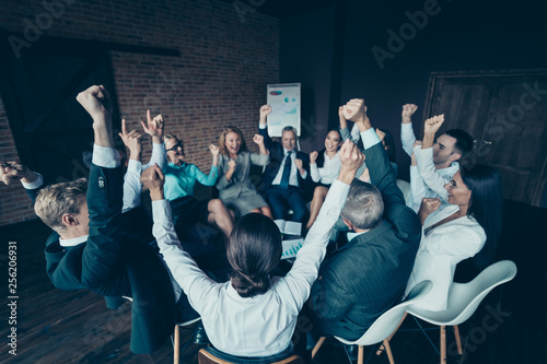 Fototapeta Nice stylish elegant cheerful cheery positive sharks marketers company ceo boss chief directors executive managers raising hands up at industrial loft interior work place space obraz