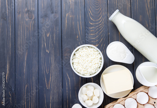 Poster Dairy products Dairy products on wooden table. Milk, cheese, egg, curd cheese and butter.