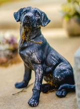 A Dog Grave Sculpture On A Gra...