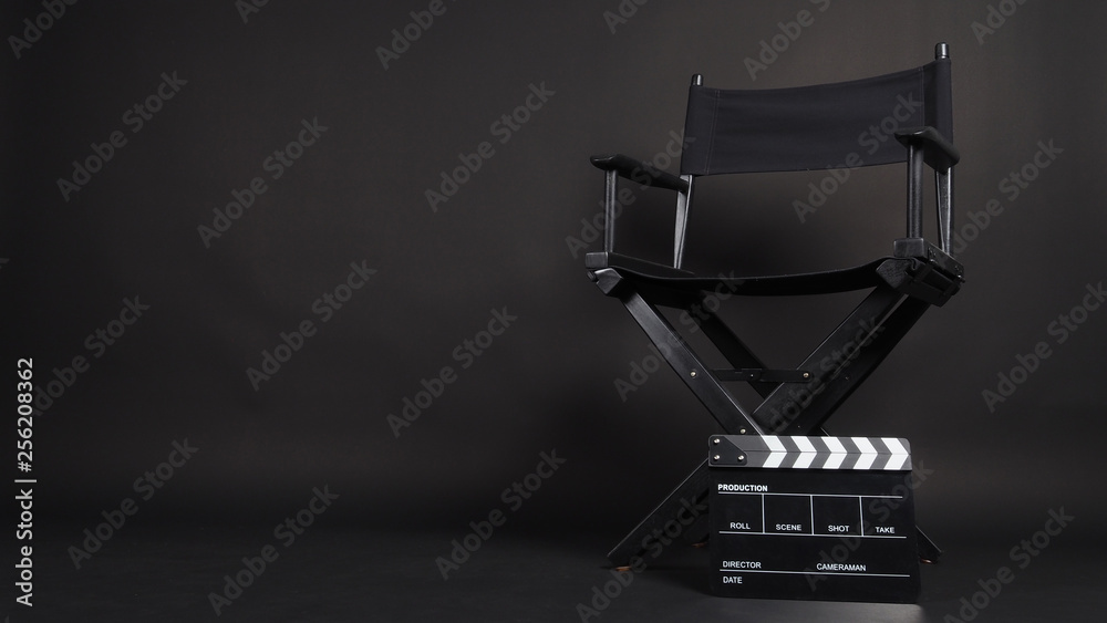 Clapper board or movie slate with director chair use in video production or movie and cinema industry. It's all black color.