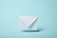 White And Blank Envelope On Bl...