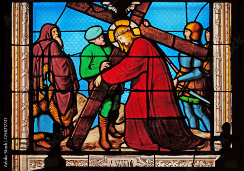 Fototapeta 5th Stations of the Cross, Simon of Cyrene carries the cross, stained glass wind
