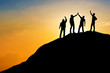 canvas print picture Group of people on peak mountain with sunset background ,team work success business  winner concept
