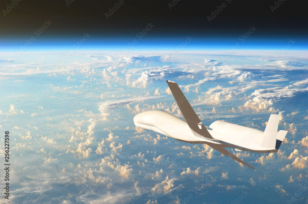 Fototapety, obrazy: Unmanned aircraft flying in the upper atmosphere, the study of the gas shells of the planet Earth. Elements of this image furnished by NASA.