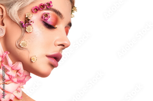Obraz na plátně  Portrait beautiful elegant girl with make-up and flowers on her face and cold wave retro hairstyle