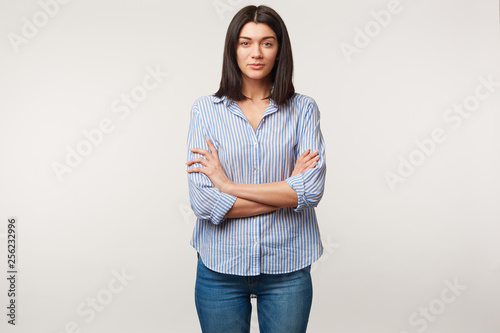 Fotografija  Young brunette woman, calm, attentive, listens with respect, pays attention, sta