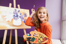 Cute Little Girl Drawing A Pic...