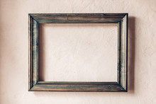 Old Wooden Frame On A Rustic Plastered Wall