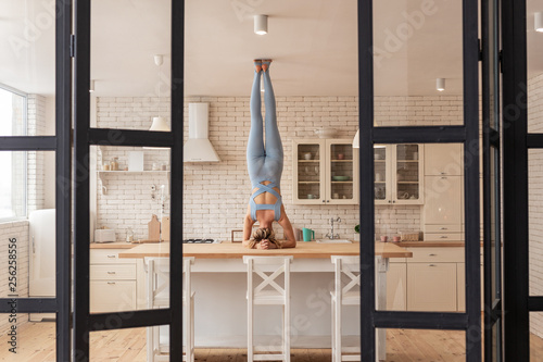 Extraordinary sportive girl pulling out her legs and touching ceiling Slika na platnu