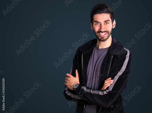 Fototapeta Handsome mixed race, south asian / indian looking man (model) wearing smart jacket and smiling obraz na płótnie