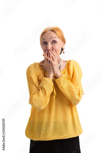 Fotografija  Senior woman covering mouth
