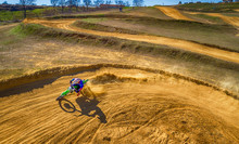Aerial View Of Racing Motocross Bikes In Racetrack. Outdoor Motor Sport From Drone View. - Image