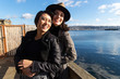 Happy lesbian couple outside near water