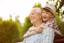 Happy Boy And His Grandpa Enjoying Warm Day Outdoors