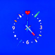 canvas print picture - Medical pharmaceutical concept. Watch from tablets, ampoules and syringes. Medication time on a blue background.
