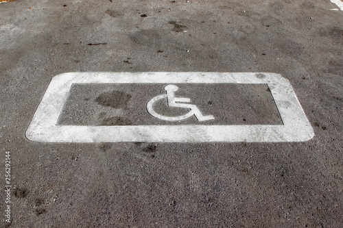 """Fotografia  Horizontal road surface marking """"A parking place reserved for disabled people"""""""