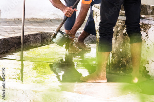 Valokuva  Men washing their feet making ablution on a fount in a mosque in Male,  Maldives