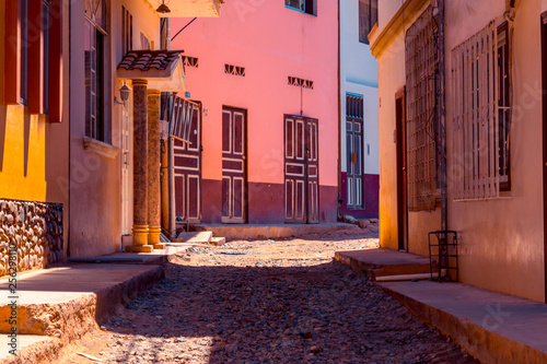 Small old stone street located in the city of Portovelo, Ecuador