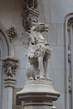 Gargoyle Sculpture In A Building Principal Door.