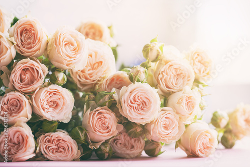 Pink roses flowers bouquet on morning sunlight background. Holiday celebration concept. #256312124