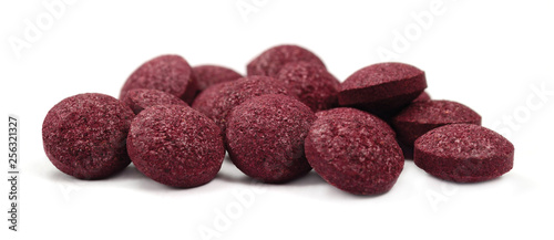 Black chokeberry fruit pills, large detailed isolated tablets macro closeup, org Canvas Print