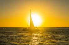 USA, Florida, Key West, Sailing Boat With Tourists At Sunset