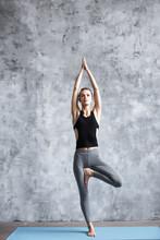 Yoga Woman Tree Pose.