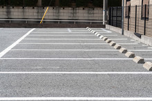 Empty Outdoor Car Parking Space And Metal Fence