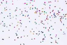 Colored Sequins Of Different Shapes On White Background