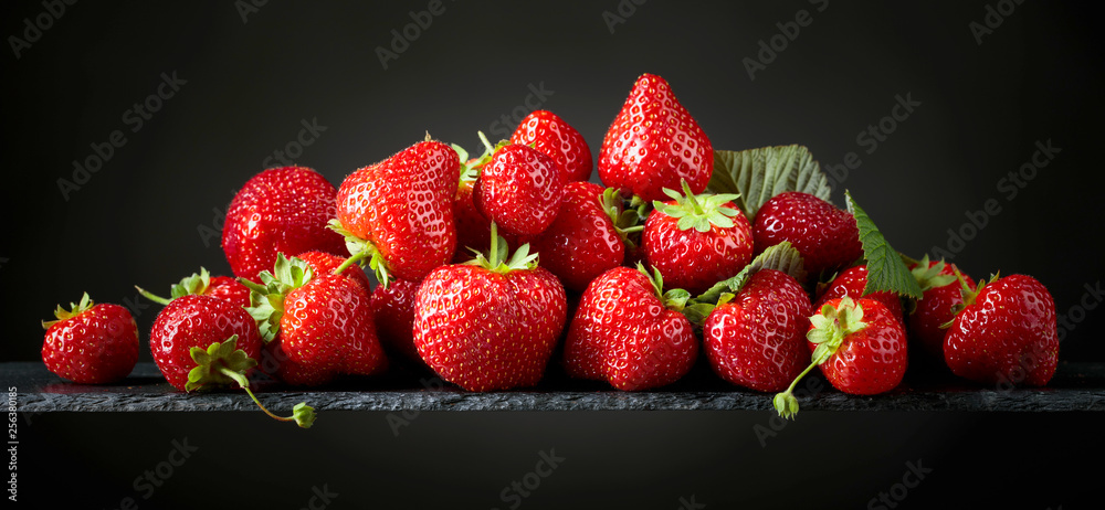 Fototapety, obrazy: Strawberries with  leaves.