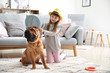 canvas print picture - Cute little girl playing with funny dog at home