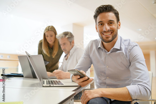 Startup team member smiling at camera in office Poster Mural XXL