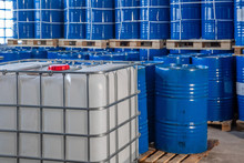 Blue Barrels In The Warehouse On Pallets