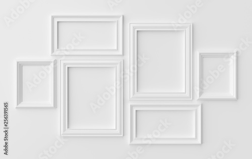 Photo White photoframes on white wall with shadows