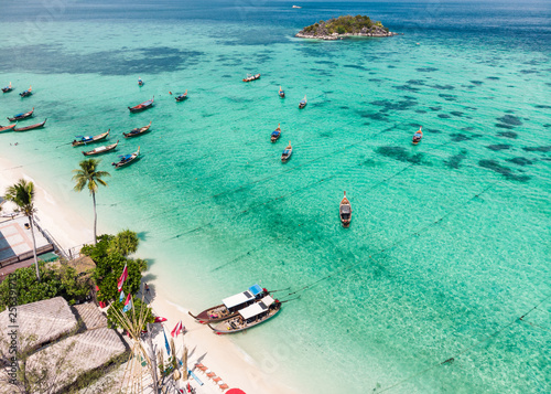 Wall Murals Green coral Beautiful tropical sea with wooden long-tail boat on the beach